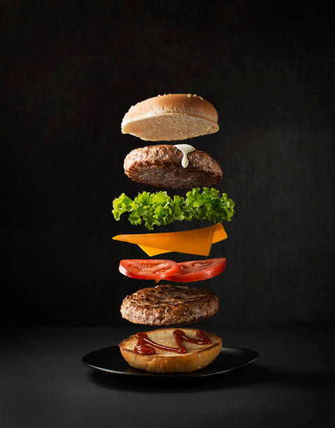 Hamburger with flying ingredients stock photo