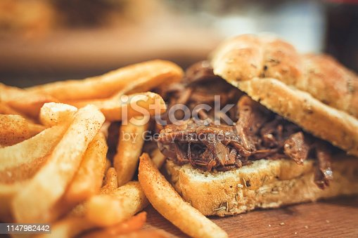 Steak burger with French fries chips