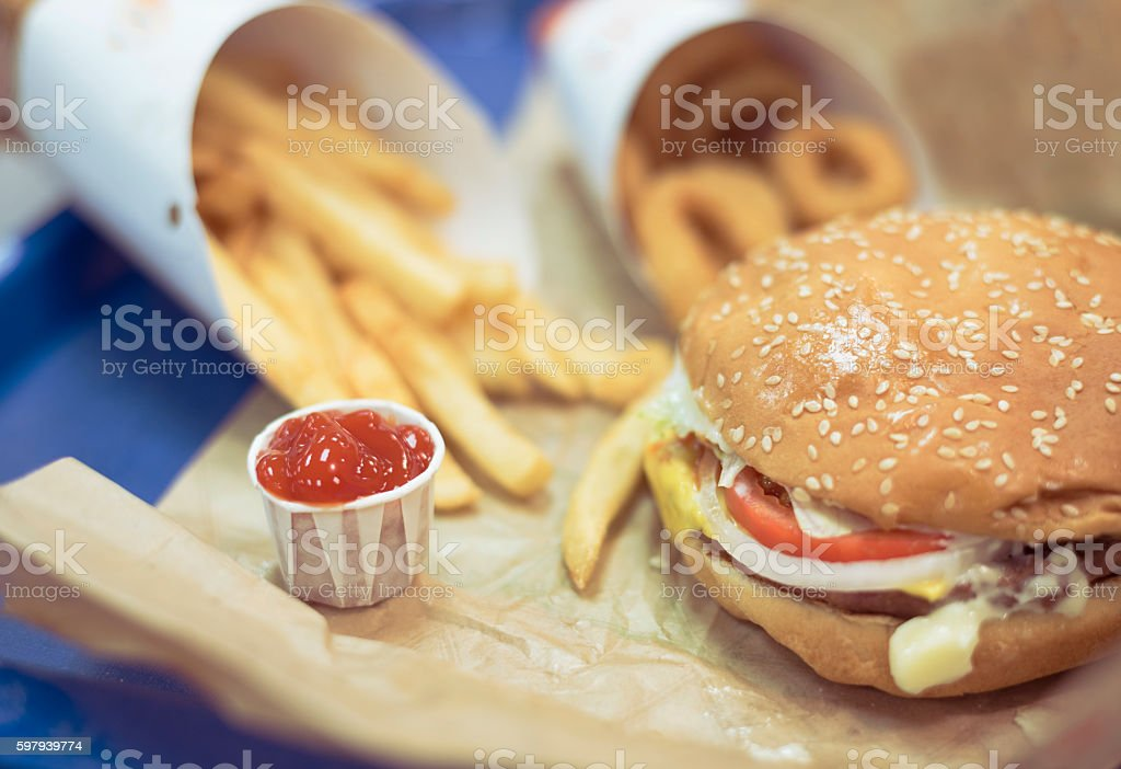 hamburger with fries, onion rings and ketchup, junk food background foto royalty-free