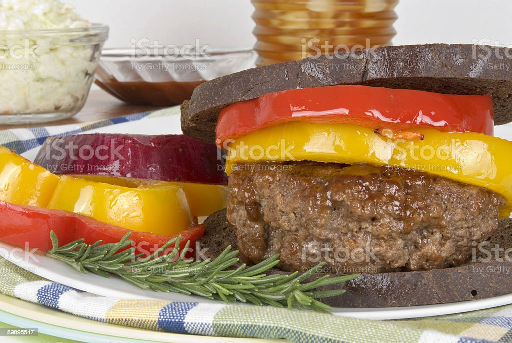 hamburger with grilled peppers on toasted pumpernickel bread royalty-free stock photo