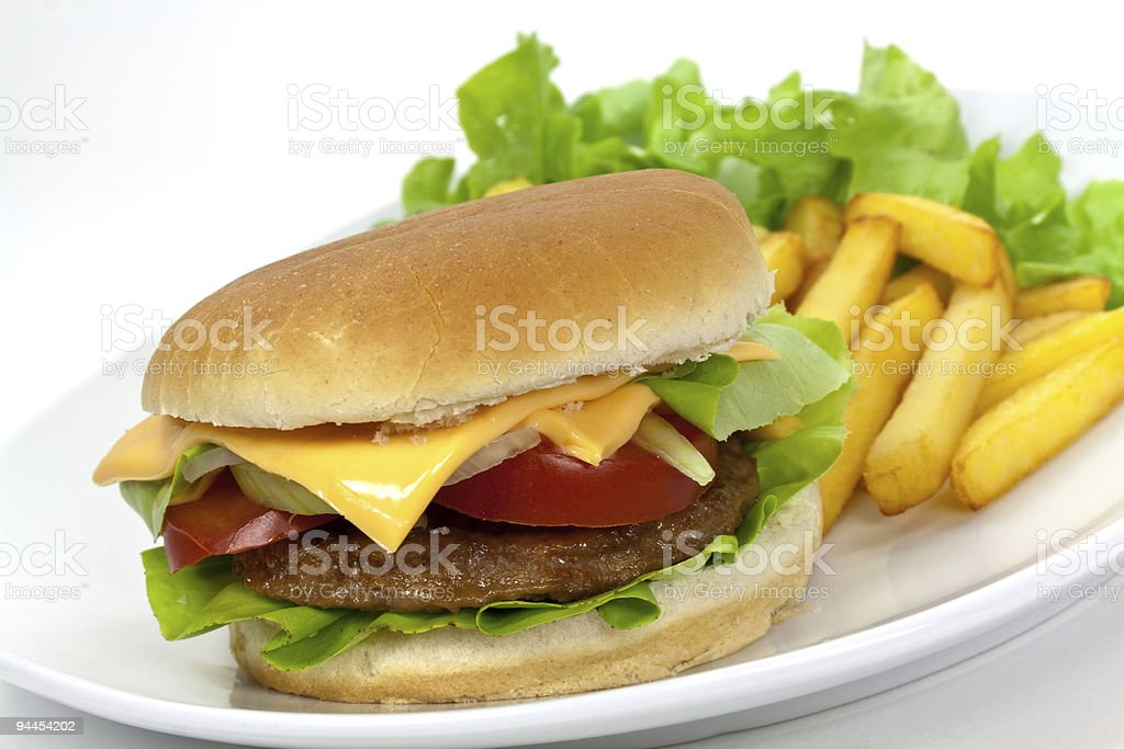 hamburger with lettuce,cheddar,tomato,fries royalty-free stock photo