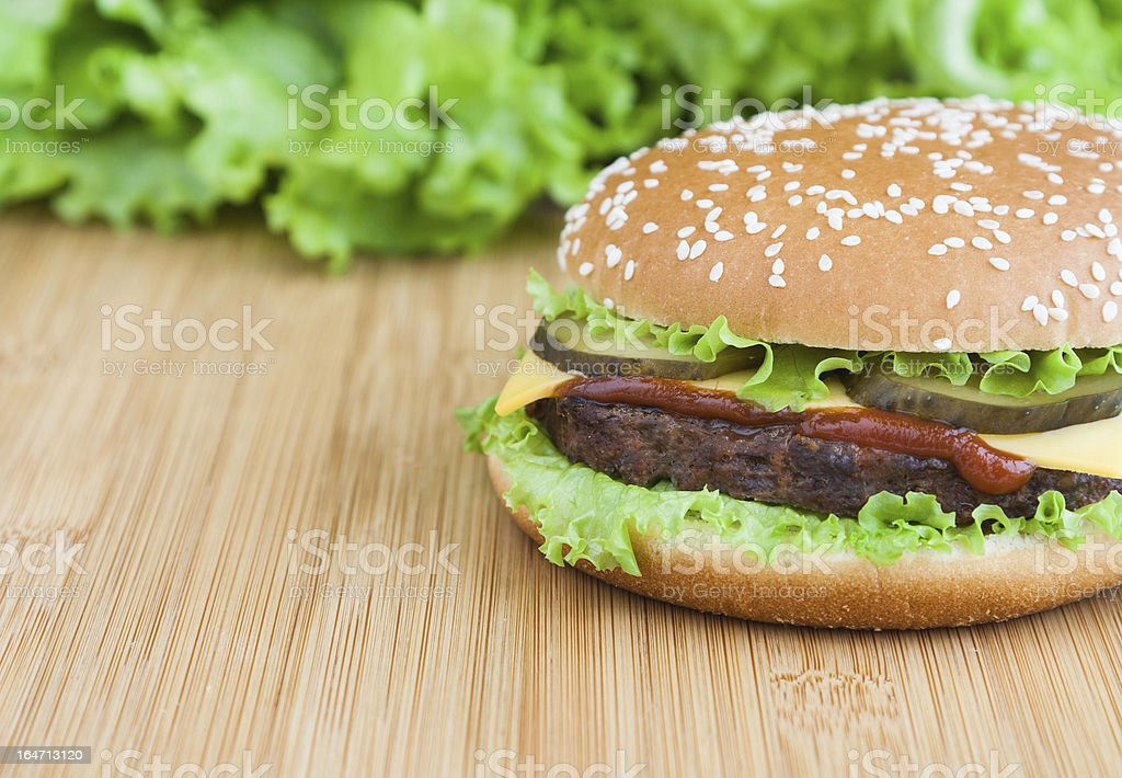 hamburger with meat cutlet and ketchup on wooden plate royalty-free stock photo