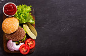 istock hamburger with vegetables, top view 865791308