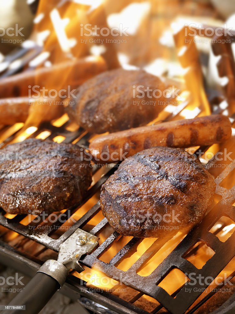Hamburgers and Hotdogs on an Outdoor Grill royalty-free stock photo