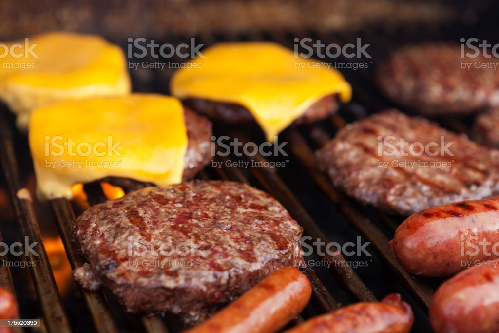 Hamburgers cheeseburgers and hot dogs on grill royalty-free stock photo