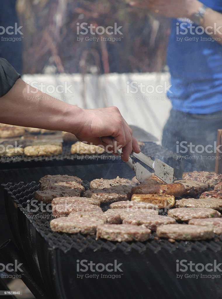 Hamburgers cooking on barbeque royalty-free stock photo