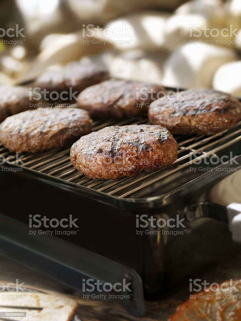 Hamburgers on an Outdoor Grill royalty-free stock photo