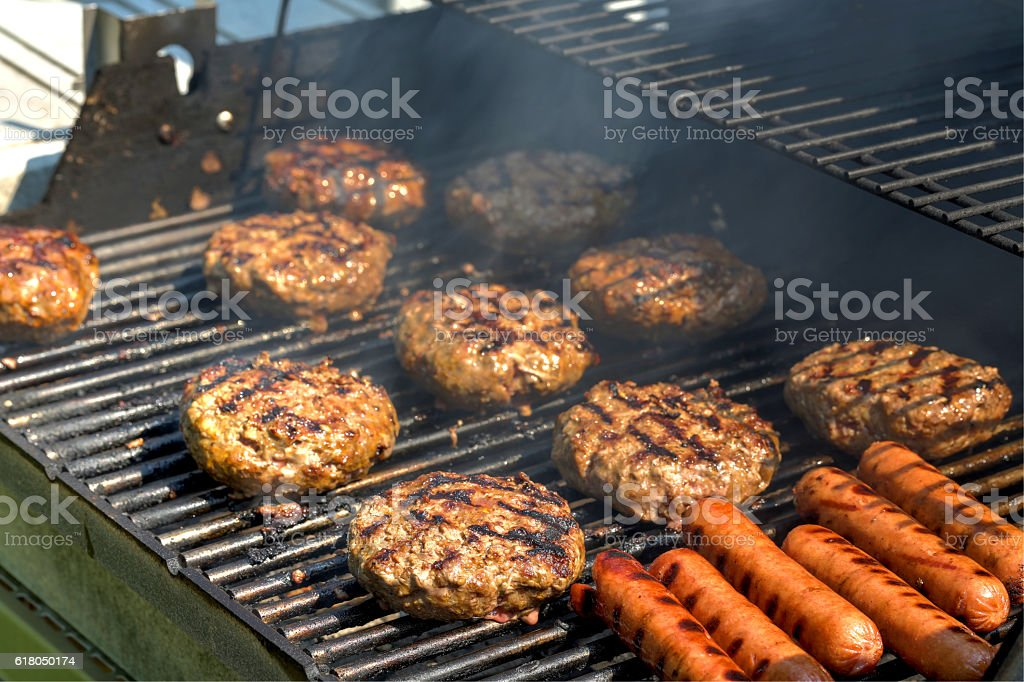 Hamburgers on the grill stock photo