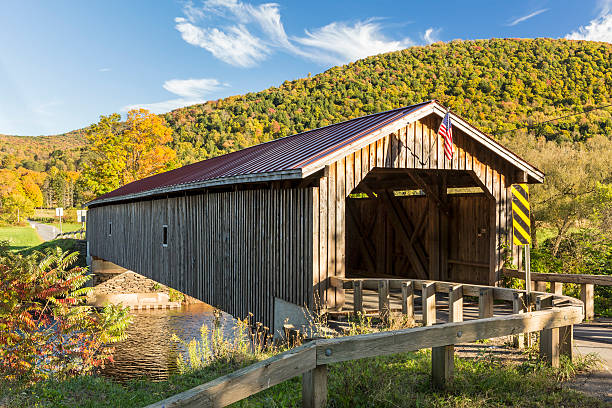 Hamden Covered Bridge in Autumn Hamden Covered Bridge set against a colorful Autumn hillside in the Catskills Mountains on New York catskill mountains stock pictures, royalty-free photos & images