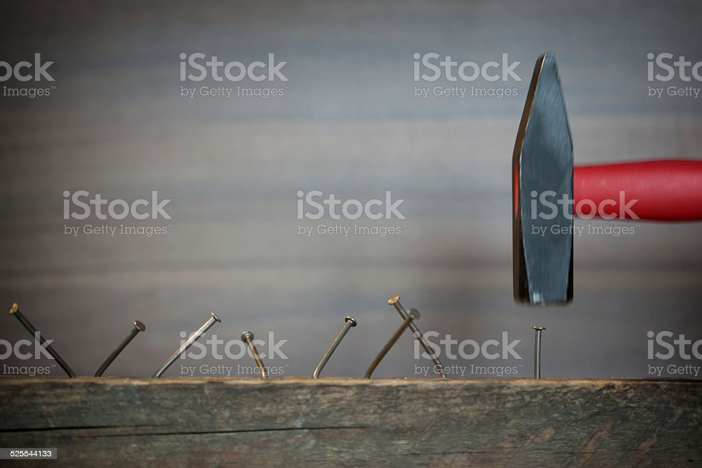 Hamer trying to hit the nail on the head stock photo