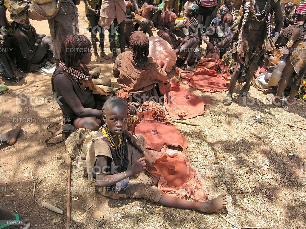 Hamer women sell ochre at market in Dimeka, Ethiopia. stock photo
