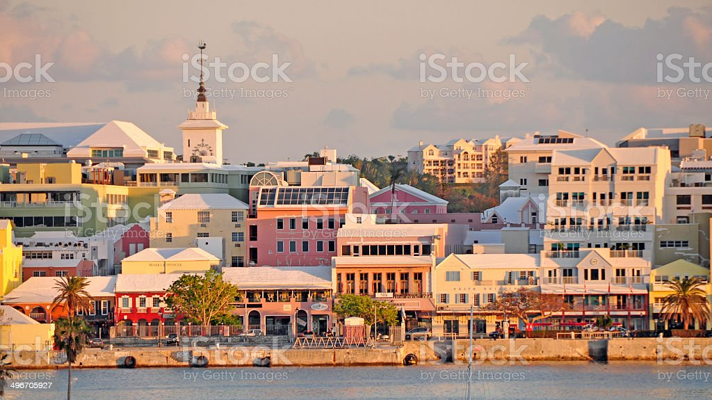 Hamilton, Bermuda... Sunset on the waterfront and Front Street. stock photo
