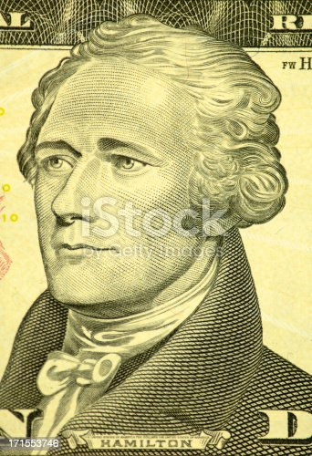 Macro image of Alexander Hamilton from the front of a ten dollar bill.