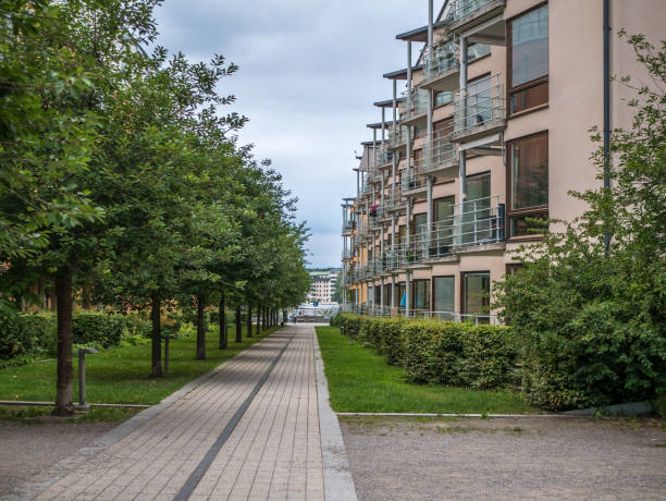 Hammarby Sjöstad, Stockholm, Sweden - 2017-08-12. Walking pathway in Hammarby Sjostad, modern buildings and trees. stock photo
