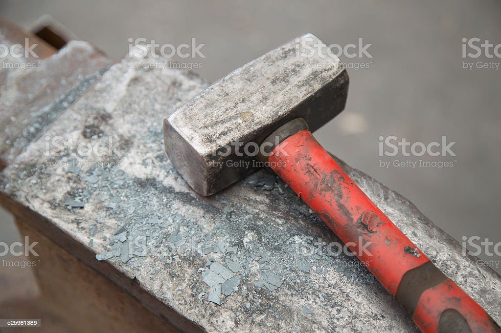 hammer and anvil used by a blacksmith stock photo
