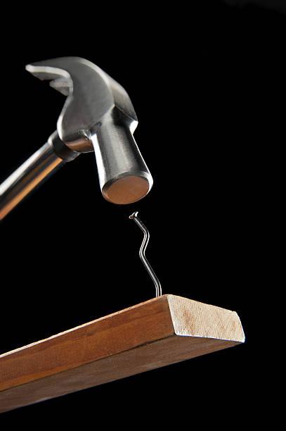 Hammer und crooked-Spike – Foto