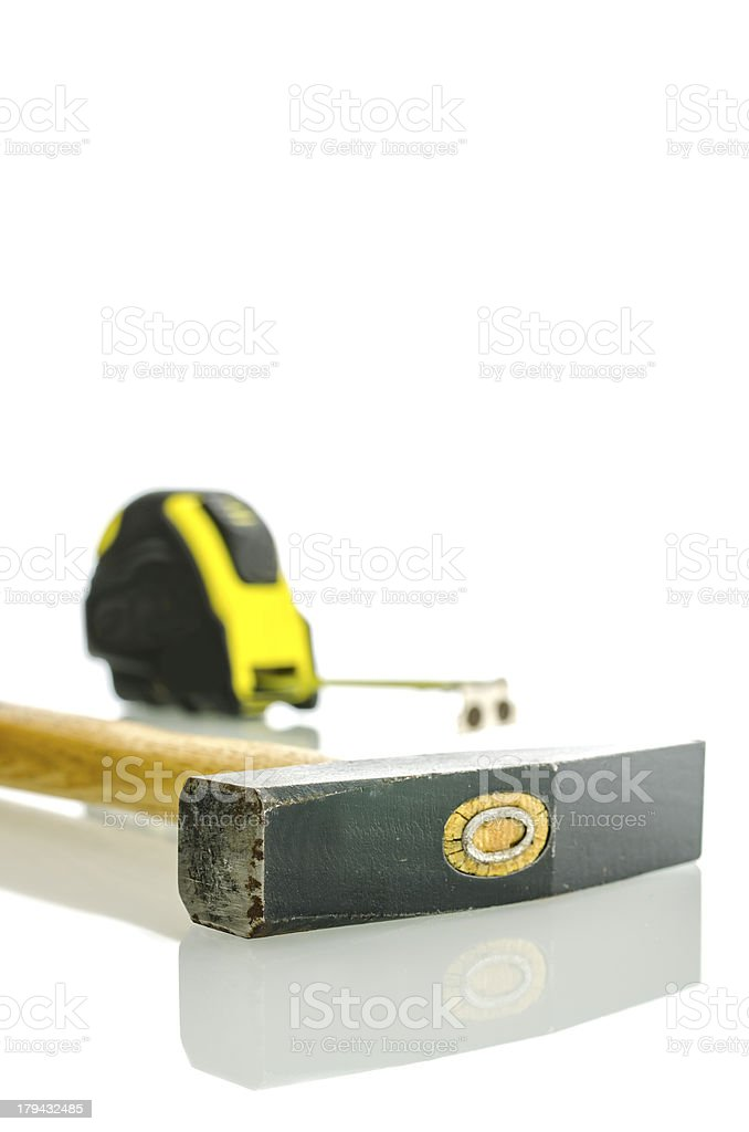 Hammer and measuring tape royalty-free stock photo