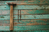 Hammer and nails on a wooden surface. Joinery tradition. Construction concept.