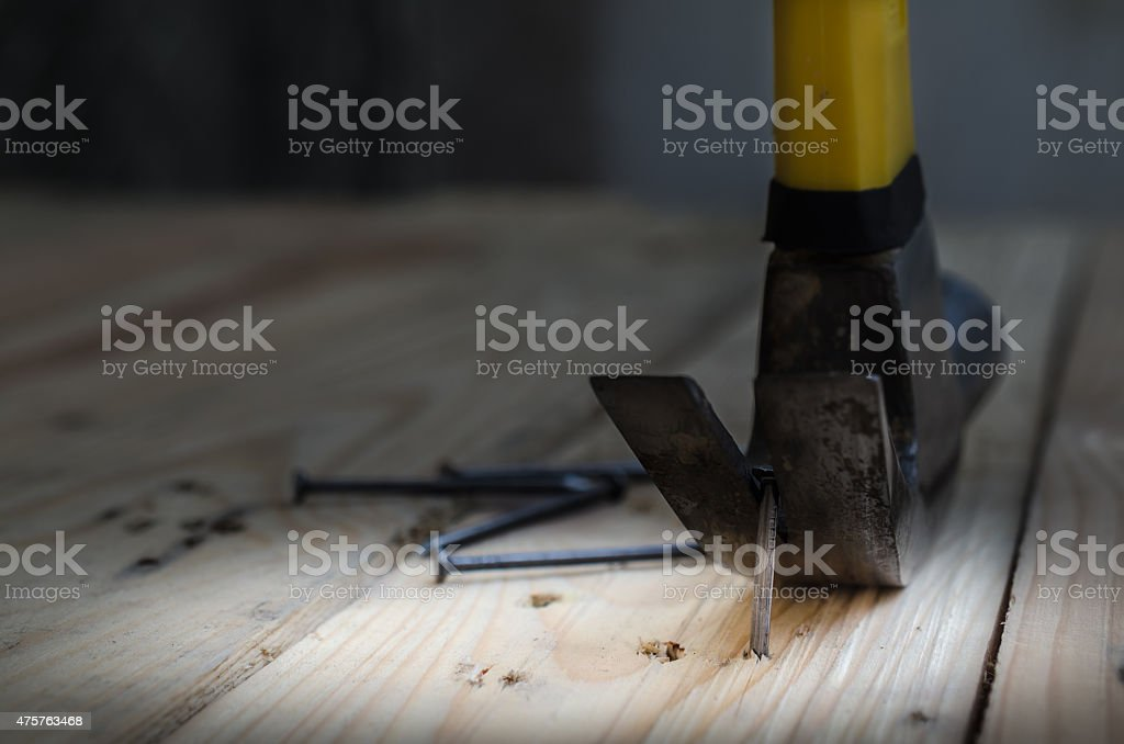 Hammer and nails on wood,claw hammer on a workbench stock photo