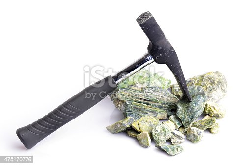 Hammer and serpentynite isolated on white background