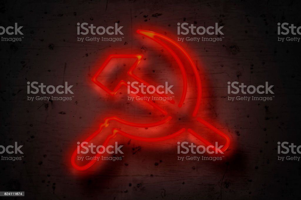 Hammer and sickle, neon sign on concrete wall stock photo