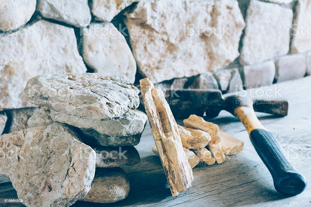 Hammer And Stack Flagstone Against The Wall Of Stone Closeup stock photo