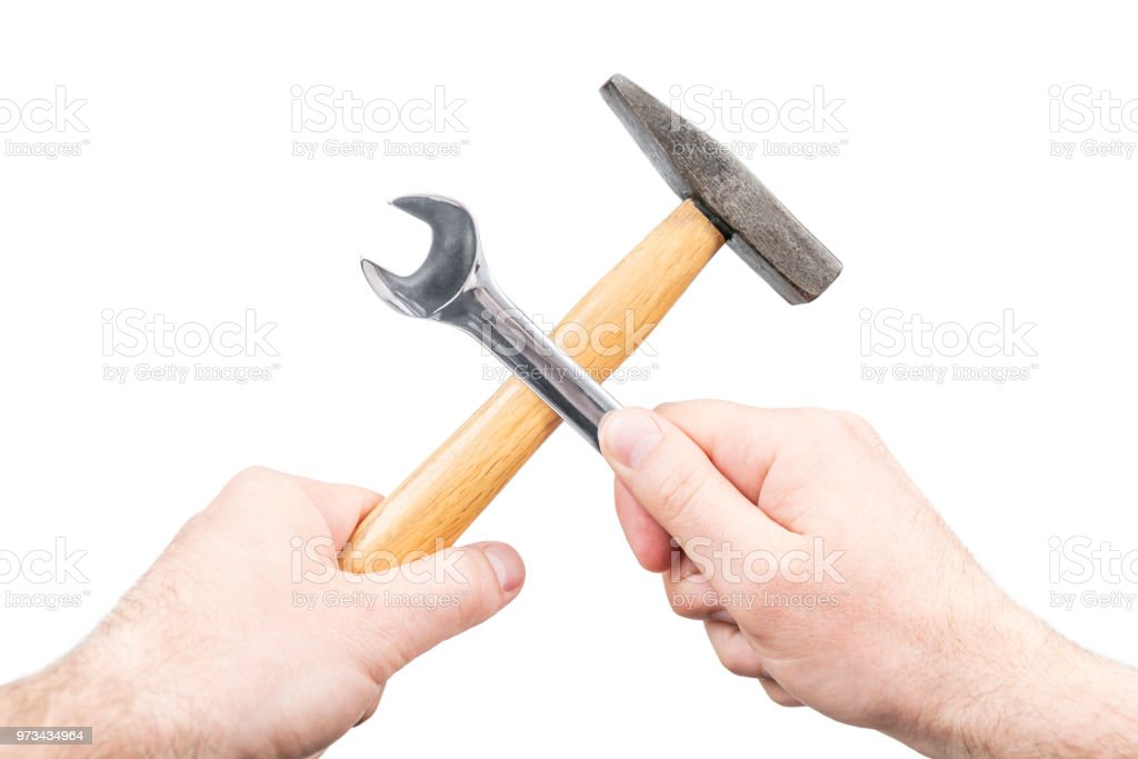 Hammer and swing wrench crosswise stock photo