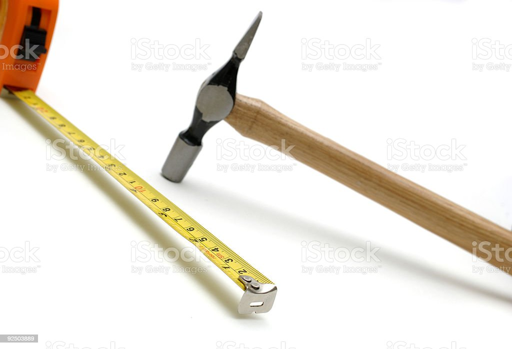hammer and tape measure, workman's tools isolated against white royalty-free stock photo