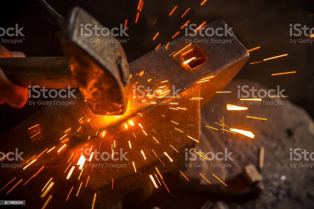 A Hammer Beat Causes Sparks stock photo