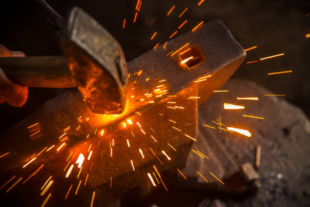 A Hammer Beat Causes Sparks A Hammer Beat Causes Sparks anvil stock pictures, royalty-free photos & images