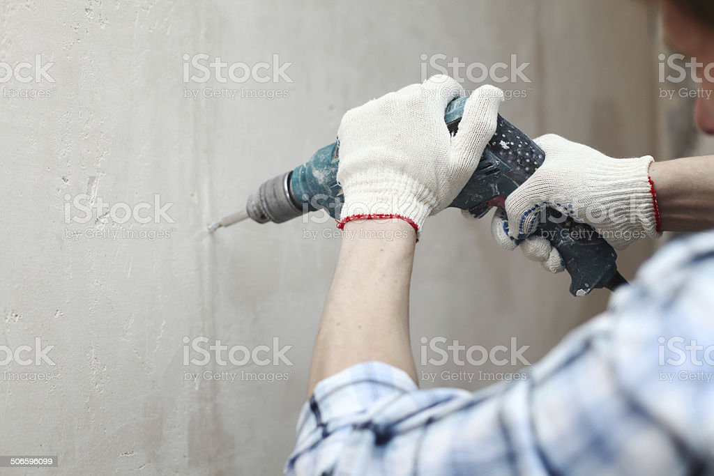 hammer drills wall – Foto