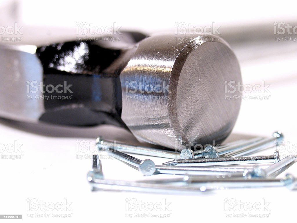 Hammer Head and a Pile of Nails stock photo