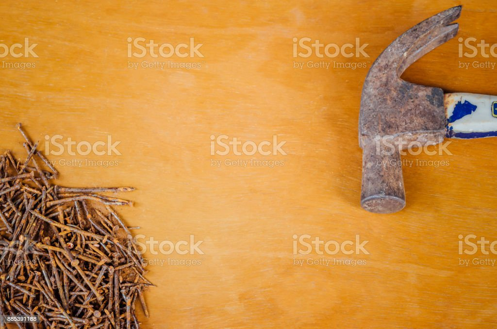 Hammer head and rusted nails stock photo