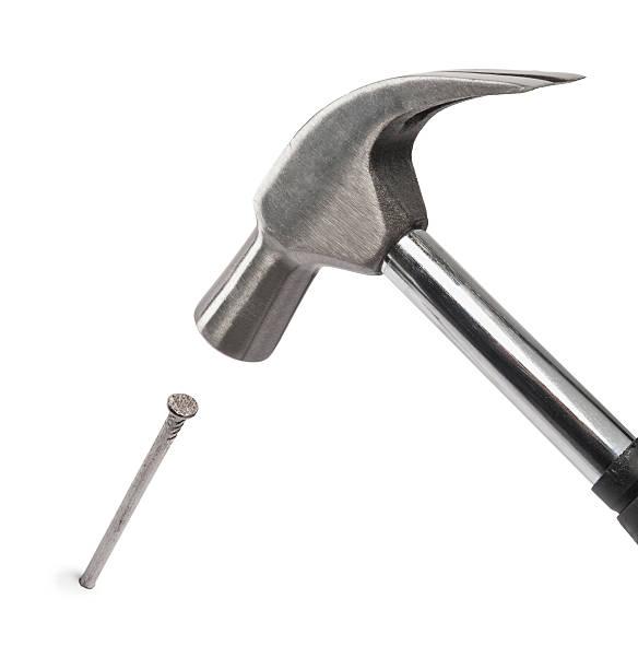 hammer schlagen einen Nagel – Foto