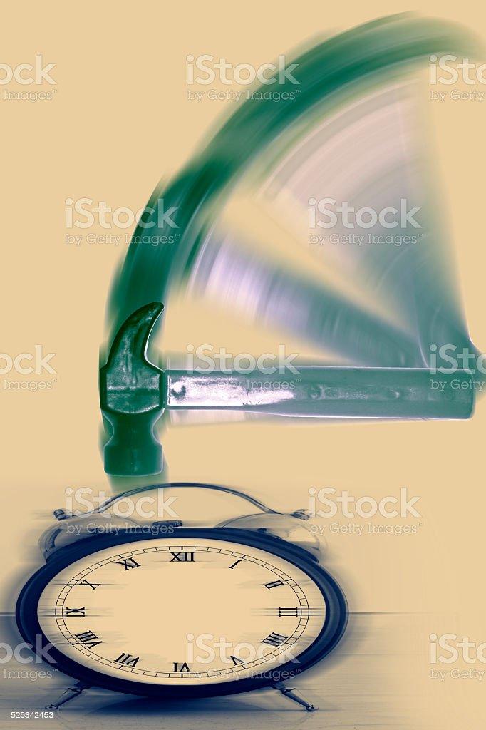 Hammer hitting Alarm Clock with motion blur stock photo