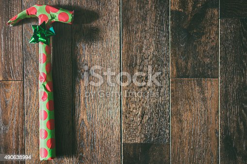 Hammer holiday gift on wood background.