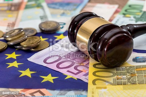 1024130248istockphoto hammer of judge to the European flag on the background of the euro 648818572