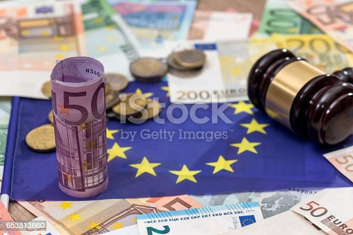 1024130248istockphoto hammer of judge to the European flag on the background of the euro 653813660