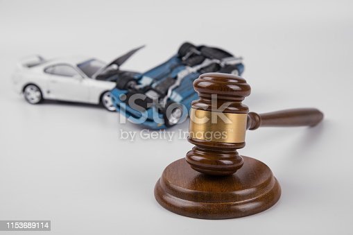 hammer of the judge. two collided cars on a white background. accident. Insurance, court case