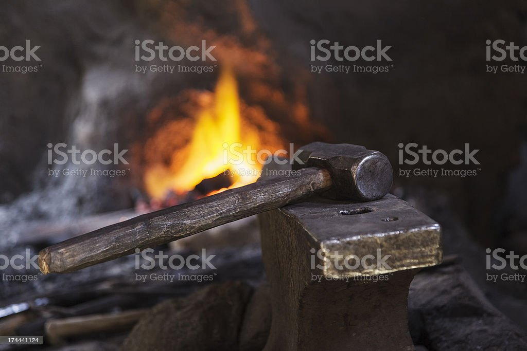 Hammer on anvil stock photo