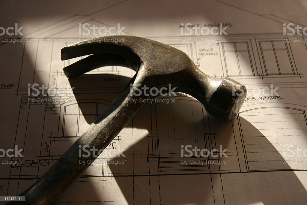 Hammer on Blueprints (sunset) I royalty-free stock photo