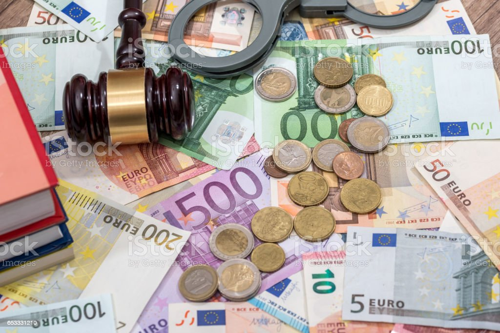 hammer on euro coin and bills. stock photo