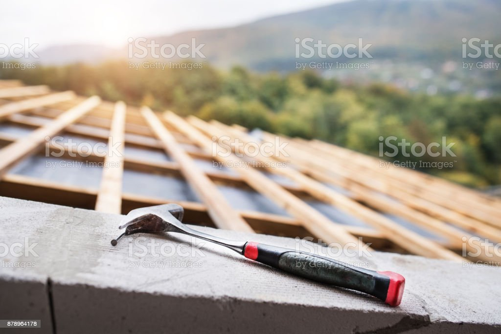 Hammer on the roof on the construction site. stock photo
