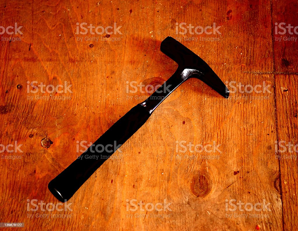 Hammer on wooden background royalty-free stock photo