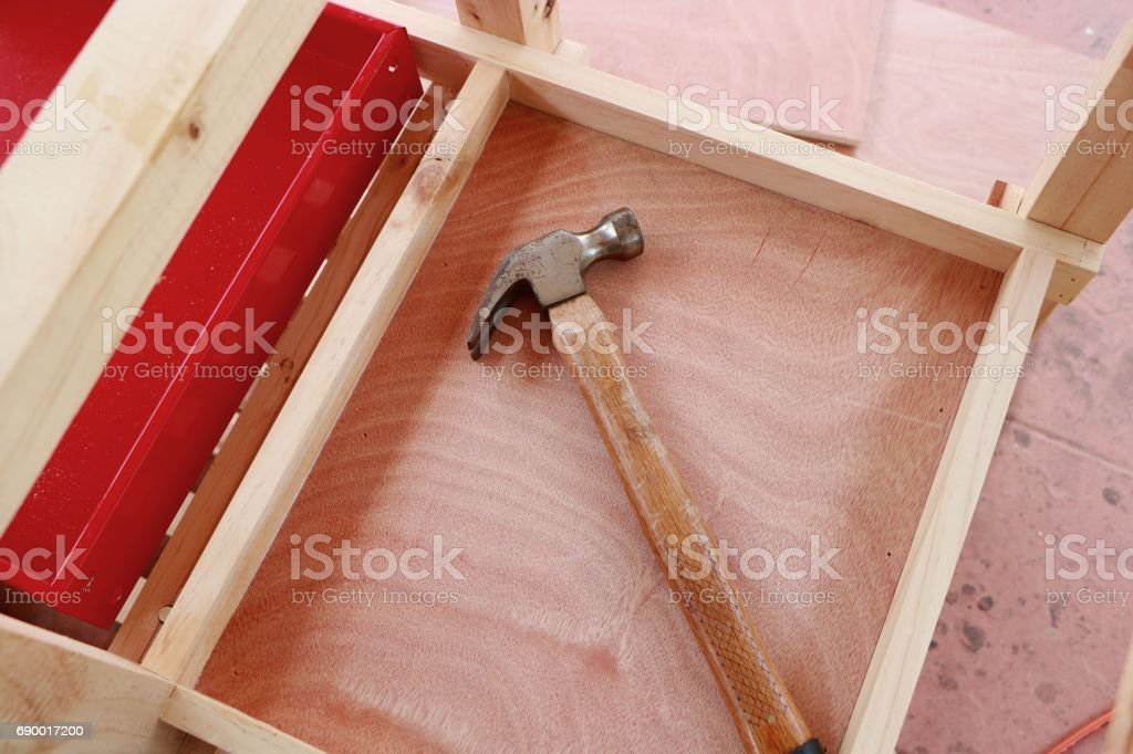 Hammer on wooden framework background stock photo