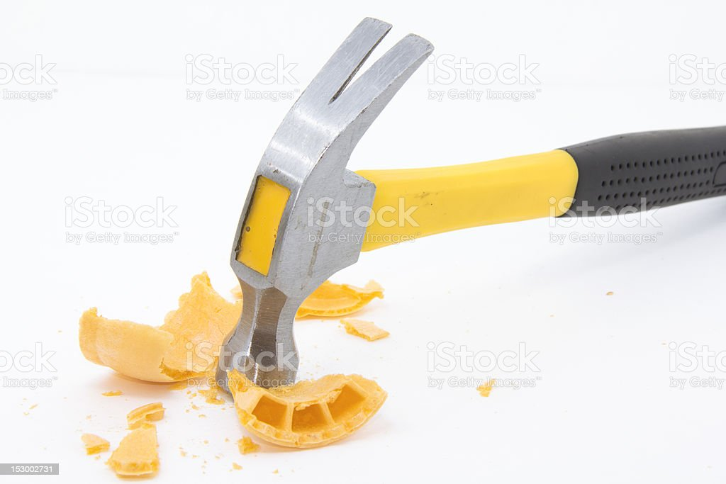 Hammer pounding an ice cream cone stock photo