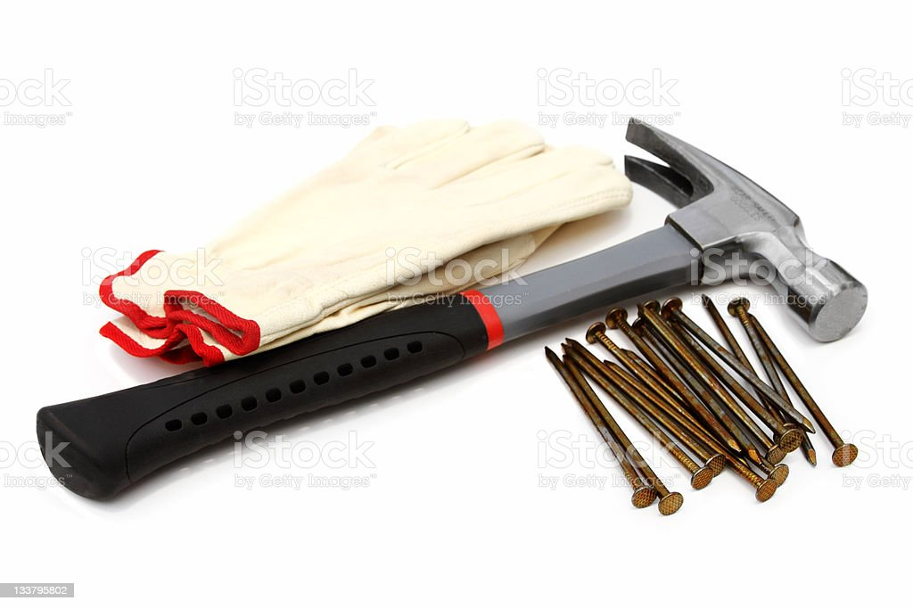 Hammer with nails and leather work gloves on white royalty-free stock photo