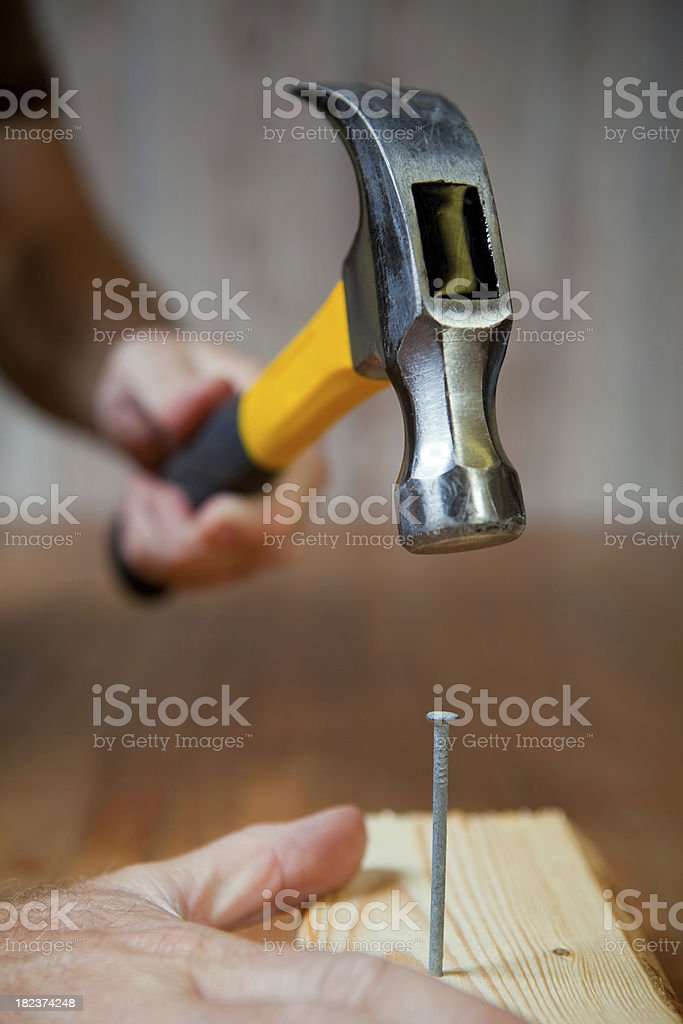 Hammering a Nail stock photo