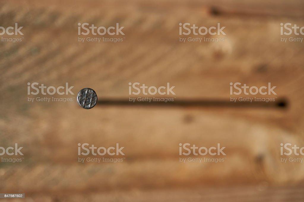 hammering a nail stock photo