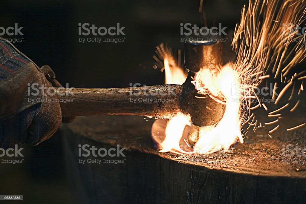 Hammering steel stock photo